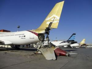 A damaged aircraft is pictured after shelling at Tripoli International Airport