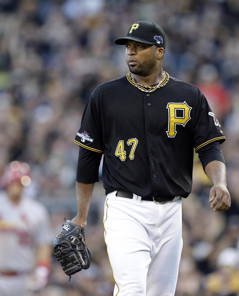 Pittsburgh Pirates starting pitcher Francisco Liriano leaves the mound after getting the third out of the third inning when St. Louis Cardinals' Matt Holliday lined out to left field with two runners on-base in Game 3 of a National League division baseball series on Sunday, Oct. 6, 2013, in Pittsburgh. (AP Photo/Gene J. Puskar)