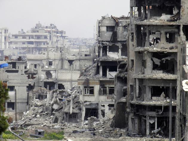 A general view of damaged buildings in Homs