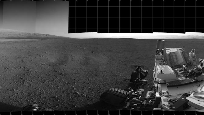This Aug. 18, 2012 image provided by NASA shows the Curiosity rover's landing site and Mount Sharp in the distance. The six-wheel rover prepared to take its first test drive on Wednesday Aug. 22,2012 as a warm-up for the long trek to the mountain expected later this year. (AP Photo/NASA)