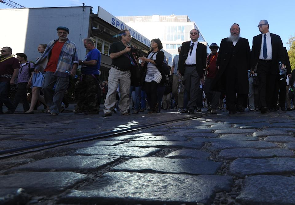 People march through former ghetto streets during commemorations marking the 70th anniversary of first transport of Jews from the Warsaw Ghetto to the Treblinka death camp during World War II,  in Warsaw, Poland, Sunday, July 22, 2012. ( AP Photo/Alik Keplicz)