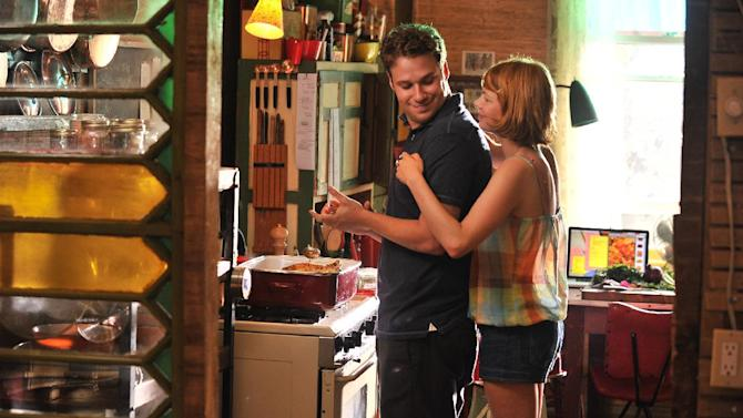 "This film image released by Magnolia Pictures shows Seth Rogan, left, and Michelle Williams in a scene from ""Take This Waltz."" (AP Photo/Magnolia Pictures)"
