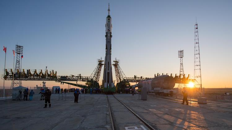 In this photo provided by NASA, the Soyuz rocket is erected into position after being rolled out to the launch pad by train at the Baikonur Cosmodrome in Kazakhstan, Monday, Dec. 17, 2012. The Soyuz spacecraft atop a towering rocket was placed into launch position Monday at Russia's manned-space facility in the freezing, windswept steppes of Kazakhstan ahead of a five-month mission for three astronauts to the International Space Station. The launch of the Soyuz rocket is scheduled for Dec. 19, 2012. (AP Photo /NASA, Carla Cioffi)