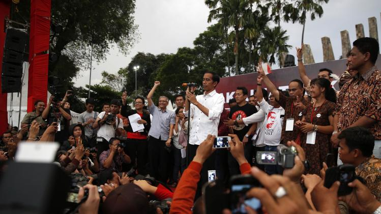 Indonesian presidential candidate Jokowi prepares to address supporters in Jakarta