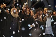 Argentine President Cristina Fernandez de Kirchner (C) waves to the crowd during a political gathering to commemorate the ninth anniversary of the election that took her late husband, former president Nestor Kirchner, to power in 2003, at Velez Sarsfield&#39;s football stadium in Buenos Aires, on April 27