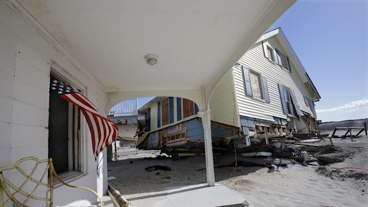 Homes destroyed last October by Superstorm Sandy are seen Thursday, April 25, 2013, in Brick, N.J. Six months after Sandy devastated the Jersey shore and New York City and pounded coastal areas of New England, the region is dealing with a slow and frustrating, yet often hopeful, recovery. (AP Photo/Mel Evans)