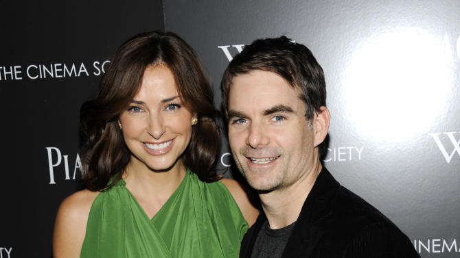 "Professional NASCAR driver Jeff Gordon and wife Ingrid Vandebosch attend a special screening of ""W.E."" at the Museum of Modern Art on Sunday, Dec. 4, 2011 in New York. (AP Photo/Evan Agostini)"