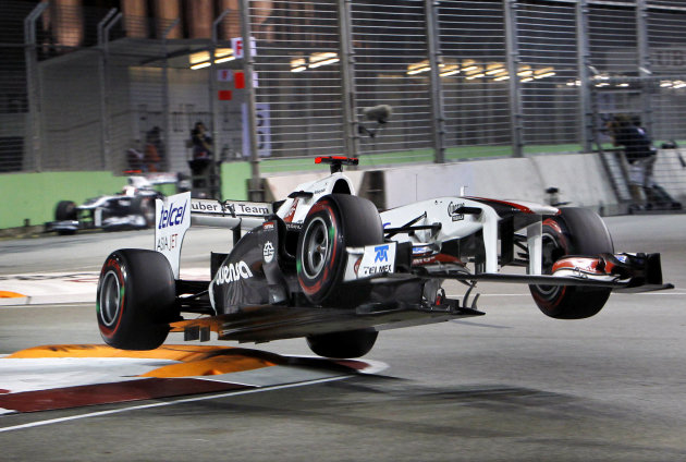 Sauber driver Kamui Kobayashi of Japan loses a control prior to a crash on the wall during the qualifying session for Sunday's Singapore Formula One Grand Prix on the Marina Bay City Circuit in Singap