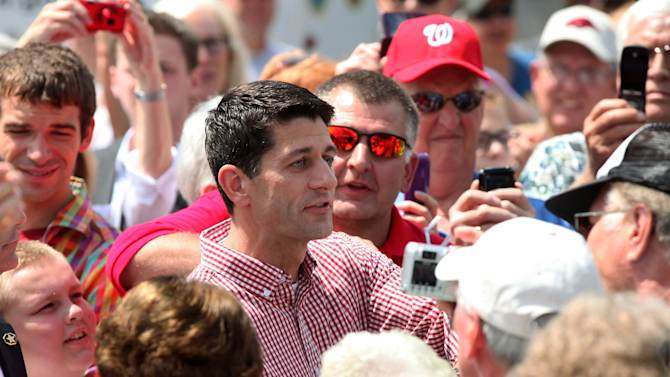 Republican Vice Presidential candidate, Rep. Paul Ryan, R-Wis. makes an appearance at the Iowa State Fair in Des Moines, Monday, Aug. 13, 2012.  (AP Photo/Conrad Schmidt)
