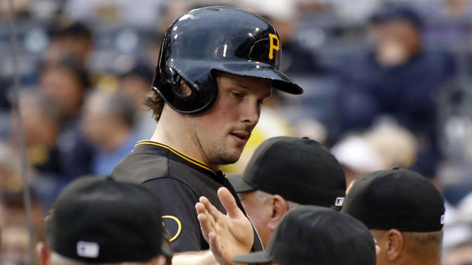Pittsburgh Pirates' Travis Snider is greeted by teammates as he heads to the dugout after scoring on a hit by Jayson Nix in the first inning of the baseball game on Monday, Aug. 11, 2014, in Pittsburgh. (AP Photo/Keith Srakocic)