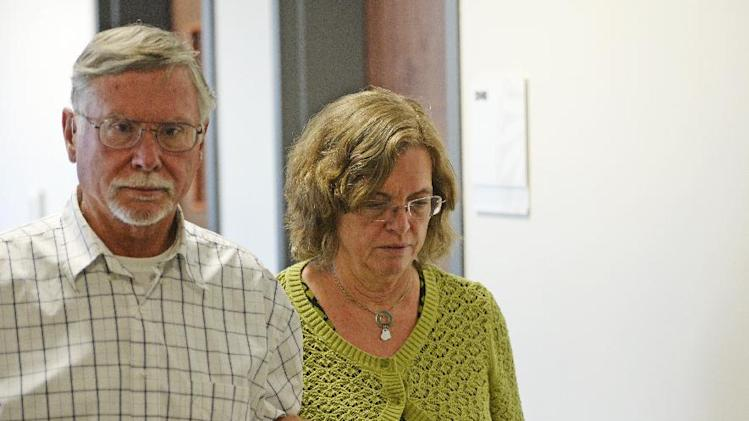 Robert and Arlene Holmes, parents of Aurora theater shooting suspect James Holmes, walk from the courtroom at the Arapahoe County Justice Center for a hearing in the 2012 Colorado movie theatre shooting case, July 22, 2014, in Centennial, Colo. The court will look at setting a new trial date in the case against James Holmes. (AP Photo/The Denver Post, RJ Sangosti, Pool)
