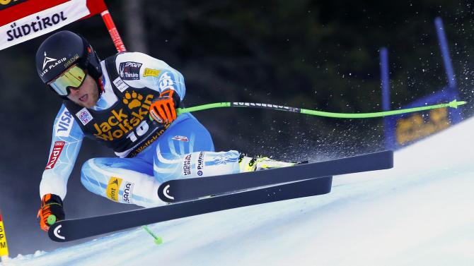 Weibrecht of the U.S. clears a gate during the men's World Cup Super-G skiing race in Val Gardena