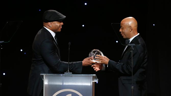 IMAGE DISTRIBUTED FOR THE PRODUCERS GUILD - LL Cool J, left, presents the 2012 PGA visionary award to Russell Simmons at the 24th Annual Producers Guild (PGA) Awards at the Beverly Hilton Hotel on Saturday Jan. 26, 2013, in Beverly Hills, Calif. (Photo by Todd Williamson/Invision for The Producers Guild/AP Images)