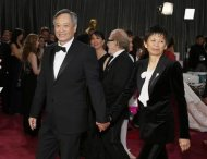 "Ang Lee, best director nominee for his film ""Life of Pi"", and his wife Jane Lin arrive at the 85th Academy Awards in Hollywood, California February 24, 2013. REUTERS/Lucy Nicholson"