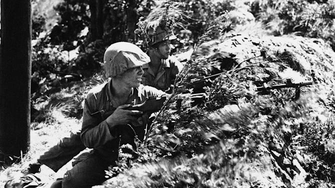 FILE - An American GI, unidentified, and a South Korean infantryman are shown together at the front somewhere in Korea on July 26, 1950. (AP Photo, File)