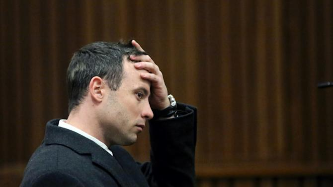 South African Paralympic athlete Oscar Pistorius sits in the dock during his ongoing murder trial in Pretoria, South Africa, on July 8, 2014