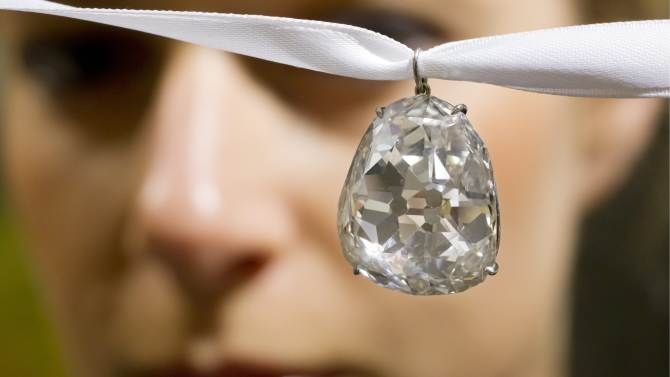 FILE - In this May 2, 2012, file photo, an employee shows the Beau Sancy diamond, 34.98 carat,  at Sotheby's auction house in Zurich, Switzerland. In May, Sotheby's sold the 34.98 carat Beau Sancy diamond to an anonymous bidder for $9.7 million. Marie de Medici had wore it at her coronation as Queen Consort of Henry IV in France in 1610. Then the diamond passed among the royal families in France, England, Prussia and the Netherlands. It was sold by the Royal House of Prussia. (AP Photo / Keystone, Alessandro Della Bella, File)