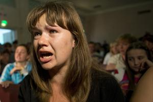 A woman from Ukraine cries at a meeting with OSCE's…