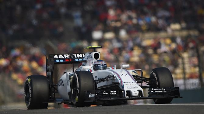 Williams Martini Racing's driver Valtteri Bottas steers his car during the Formula One Chinese Grand Prix in Shanghai on April 12, 2015
