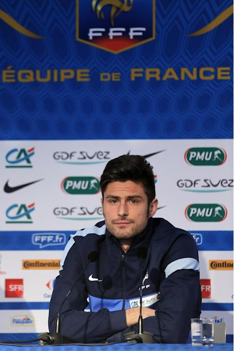 France's soccer player Olivier Giroud gives a press conference, at Clairefontaine training center, south of Paris, Sunday, Nov. 17, 2013. Ukraine stunned France with two second-half goals on Friday to