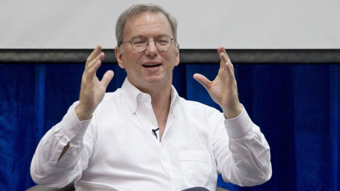 "In this Friday, March 22, 2013, Google Executive Chairman Eric Schmidt gestures during  an interactive session with group of students at a technical university in Yangon, Myanmar Schmidt, who spent a decade as the company's CEO, shares his ruminations and visions of a radically different future in ""The New Digital Age,"" a book that goes on sale Tuesday, April 23, 2013. (AP Photo/Gemunu Amarasinghe)"
