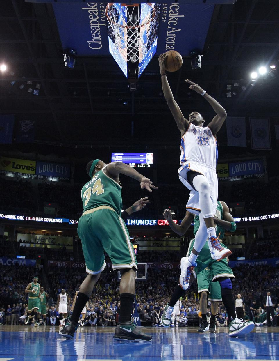 Oklahoma City Thunder forward Kevin Durant (35) shoots in front of Boston Celtics forward Paul Pierce (34) in the first quarter of an NBA basketball game in Oklahoma City, Sunday, March 10, 2013. (AP Photo/Sue Ogrocki)