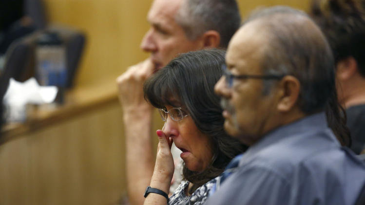 Sandra Arias, mother of Jodi Arias, wipes tears away as her daughter addresses the jury on Tuesday, May 21, 2013, during the penalty phase of her murder trial at Maricopa County Superior Court in Phoenix.  Arias was convicted of first-degree murder in the stabbing and shooting to death of Travis Alexander in his suburban Phoenix home in June 2008. (AP Photo/The Arizona Republic, Rob Schumacher, Pool)