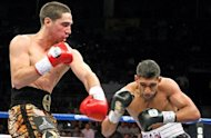 American Danny Garcia (L) throws a left at Britain's Amir Khan during their WBA light welterweight fight on July 14 in Las Vegas. Garcia added the WBA light welterweight belt to his collection with a stunning fourth-round upset of Khan in a unification title fight
