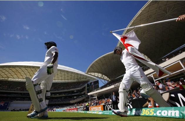 England's Carberry and Root walk onto the ground at the start of the third day's play in the second Ashes cricket test against Australia at the Adelaide Oval