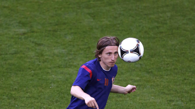 Croatia's Luka Modric watches a ball during the official training on the eve of the Euro 2012 soccer championship Group C match between Ireland and Croatia in Poznan, Poland, Saturday, June 9, 2012. (AP Photo/Jon Super)