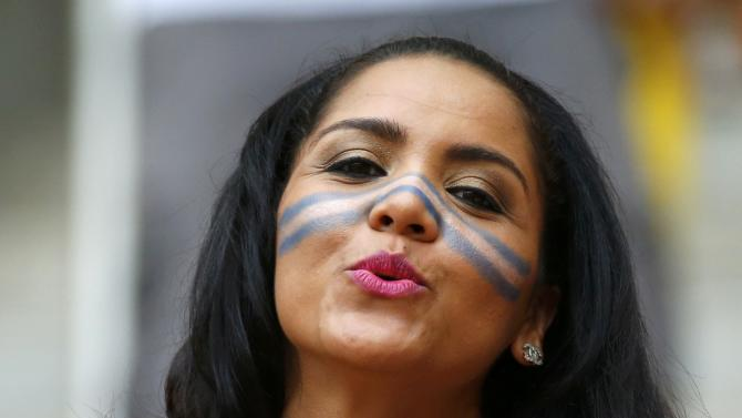 A Honduras fan poses before the 2014 World Cup Group E soccer match between Honduras and Switzerland at the Amazonia arena