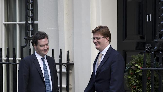 Britain's Chancellor of the Exchequer George Osborne, left and his deputy the Financial Secretary to the Treasury Danny Alexander walk out of No 11 Downing Street following a cabinet meeting Tuesday, Dec. 4, 2012. (AP Photo/Alastair Grant)