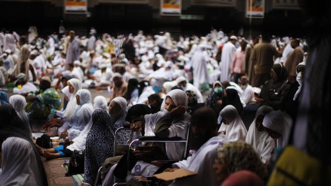 Muslim pilgrims attend Friday prayers at the Grand mosque in the holy city of Mecca ahead of the annual haj pilgrimage