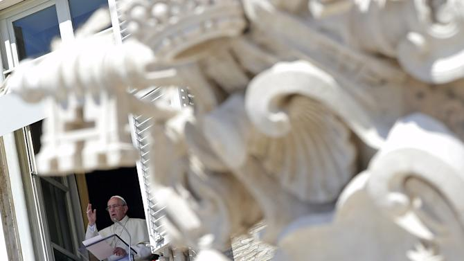 Pope Francis blesses from the window during his Sunday Angelus prayer in Saint Peter's square at the Vatican