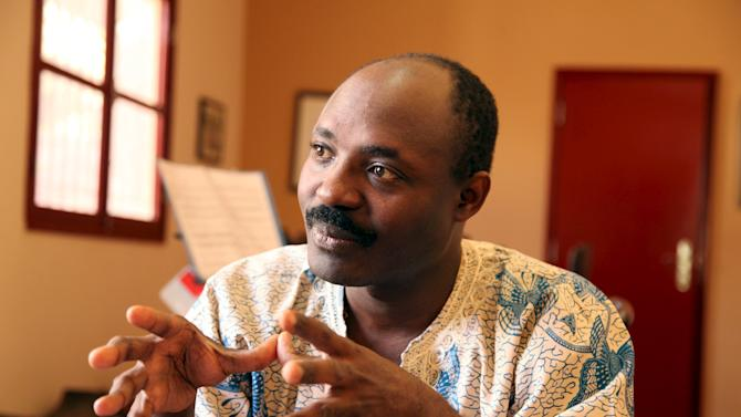 Journalist Rafael Marques Morais gestures during an interview at his home in Luanda