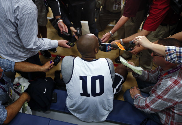 United States guard Kobe Bryant (10) talks to reporters during a men's team basketball practice at the 2012 Summer Olympics, Saturday, July 28, 2012, in London. (AP Photo/Jae C. Hong)