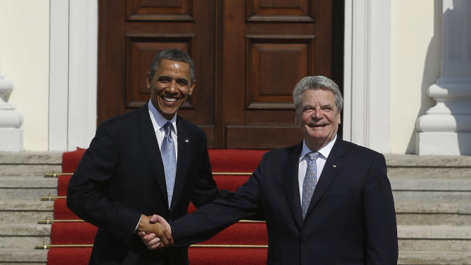 U.S. President Barack Obama, left, is greeted by German President Joachim Gauck, right, during his arrival at Schloss Bellevue, in Berlin, Germany, Wednesday, June 19, 2013. Obama is on a 24-hour visit to Germany, the culmination of which will be a speech at Berlin's iconic Brandenburg Gate. (AP Photo/Pablo Martinez Monsivais)
