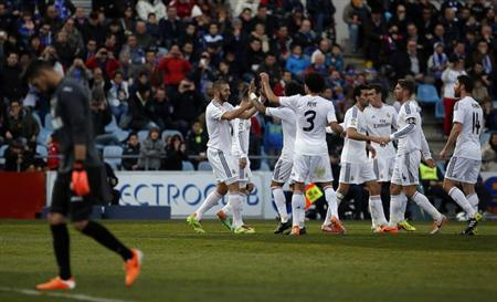Real Madrid's Karim Benzema (2nd L) celebrates his goal against Getafe with teammates during their Spanish first division soccer match at Coliseum Alfonso Perez stadium in Getafe, outside Madrid,