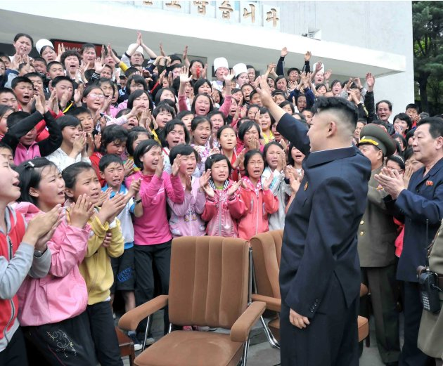 North Korean leader Kim Jong-un waves during a visit to the Pyongyang Myohyangsan Children's Camp, situated at the foot of Mt. Myohyang in North Phyongan Province in this photo released by North Korea