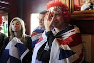 Fans of tennis player Andy Murray react as they watch his Australian Open final match in the bar of The Dunblane Hotel in his hometown of Dunblane, Scotland on January 31, which he narrowly failed to win. Murray is now a strapping 25-year-old and bidding to become Britain's first men's champion at Wimbledon since 1936