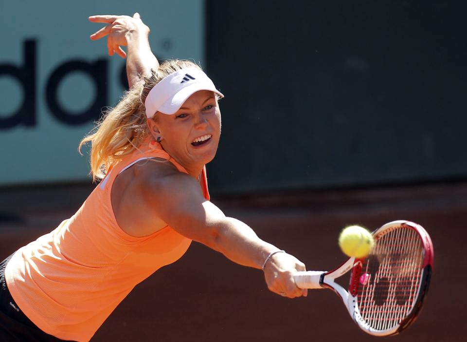 Denmark's Caroline Wozniacki returns the ball as she trains for the French Open tennis tournament at the Roland Garros stadium in Paris, Saturday, May, 26, 2012.  (AP Photo/Michel Euler)