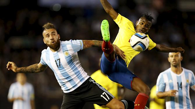 Ecuador's Miller Bolanos competes for the ball with Argentina's Nicolas Otamendi during their 2018 World Cup qualifying soccer match at the Antonio Vespucio Liberti stadium in Buenos Aires