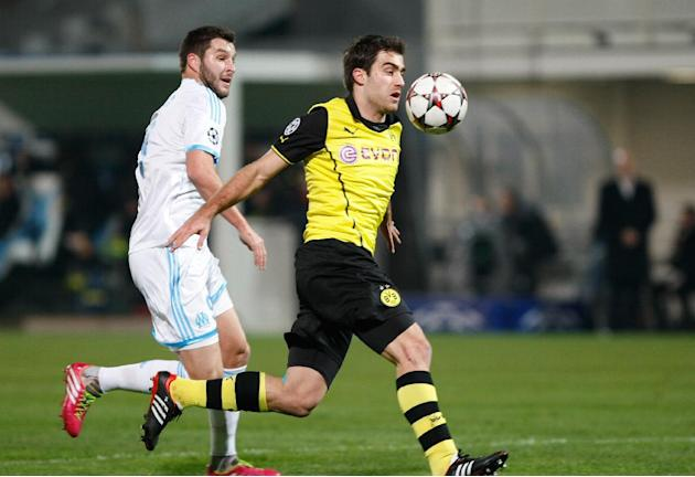 Dortmund's Sokratis, right, out runs Marseille's Andre-Pierre Gignac during the Group F Champions League soccer match between Olympique Marseille and Borussia Dortmund at the Velodrome stadium