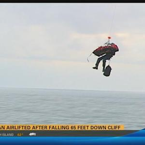 Woman airlifted after falling 65 feet down cliff