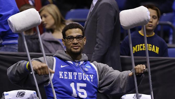 Kentucky's Willie Cauley-Stein is seen on the bench with crutches before an NCAA Midwest Regional final college basketball tournament game against Michigan Sunday, March 30, 2014, in Indianapolis