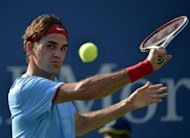 Roger Federer of Switzerland eyes a return against Fernando Verdasco of Spain during their 2012 US Open men&#39;s singles match at the USTA Billie Jean King National Tennis Center in New York. Federer won 6-3, 6-4, 6-4