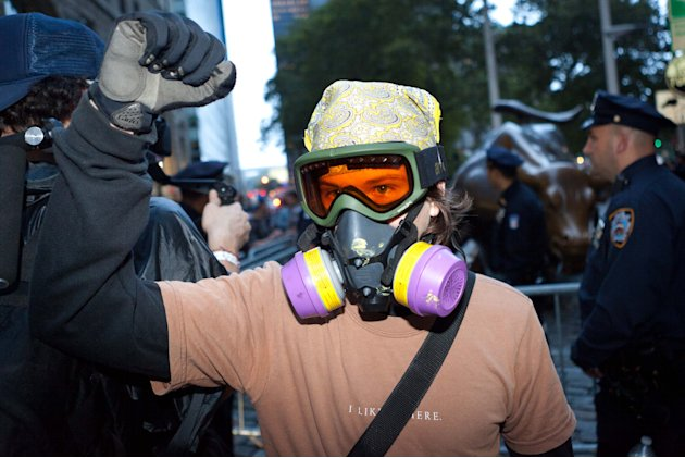 An Occupy Wall Street protestor is prepared for pepper spray and tear gas as hundreds march towards Wall Street after being heartened by the postponement of a scheduled cleanup of their camp at Zucott
