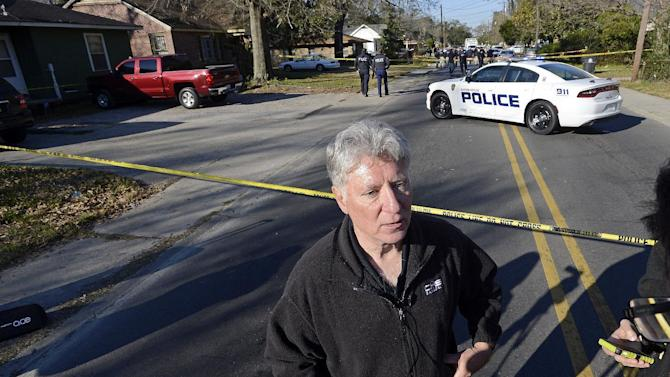 District Attorney Hillar Moore speaks during a news conference following a shooting in Baton Rouge, La., Saturday, Feb. 13, 2016. Baton Rouge police officers who were shot early Saturday during a confrontation with a suspect were responding to a call about someone damaging property. (AP Photo/Bill Feig)