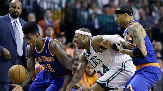New York Knicks' Iman Shumpert (21) tries to control the ball as Boston Celtics' Paul Pierce (34) struggles with Knicks' Kenyon Martin, far right, during the second half in Game 4 of a first round NBA basketball playoff series in Boston, Sunday, April 28, 2013. The Celtics won 97-90 in overtime. (AP Photo/Elise Amendola)