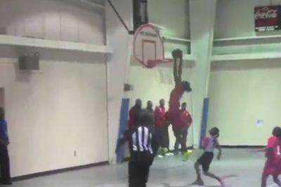 Watch this 11-year-old girl dunk four times in one game